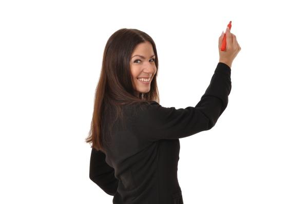 geschaeftsfrau dreht sich beim schreiben um