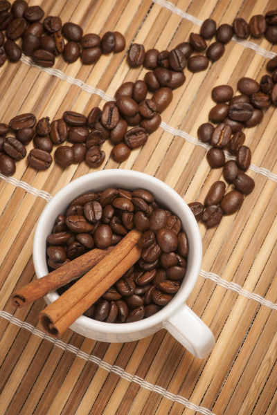 cup with coffee beans and cinnamon