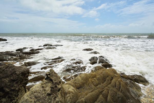 stone beach with rough sea captain