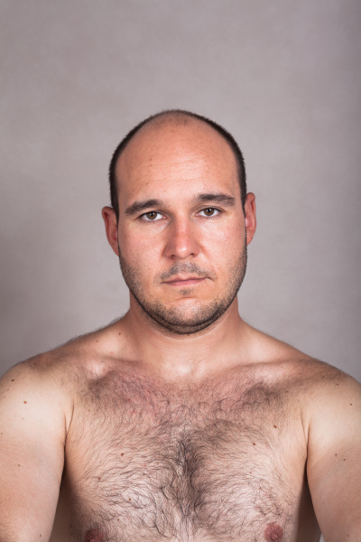 serious shirtless man with his hairy