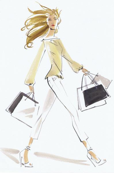 schoene frau streift mit einkaufstaschen