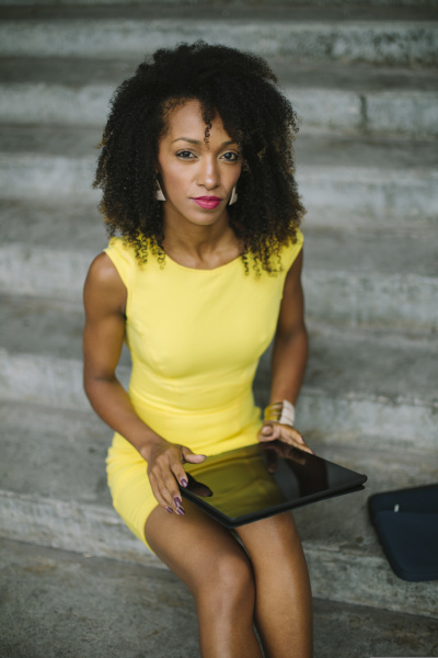 portrait, of, fashionable, businesswoman, in, yellow - 26361514