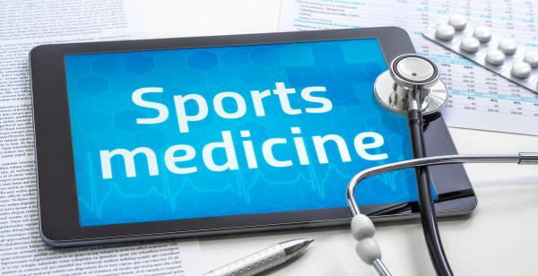 das wort sportmedizin auf dem display