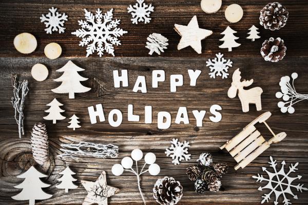 hoelzerne weihnachtsdekoration frohe feiertage schwarz und