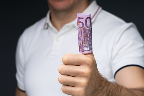 showing rolled up 500 euro note