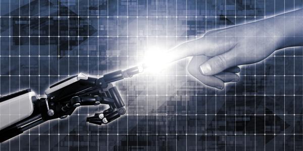 roboter und menschliche finger beruehren
