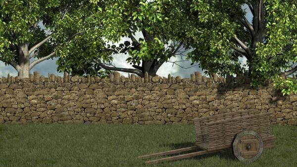 alter wagen vor der steinmauer und