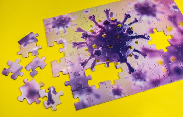 studiofoto puzzle mit coronavirus modell