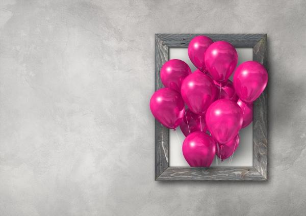 rosa luftballons gruppe in einem bilderrahmen