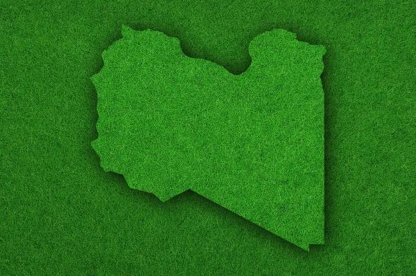karte von libyen auf gruenem filz
