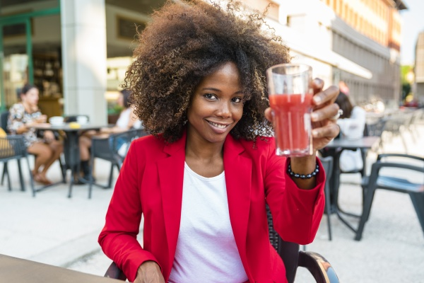 mid, adult, woman, holding, juice, glass - 29122092