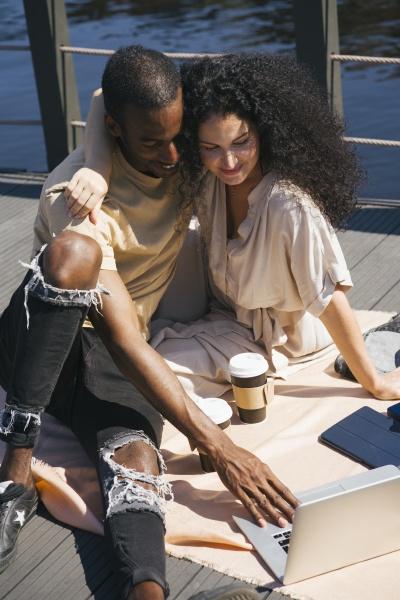couple, using, laptop, while, sitting, on - 29128693