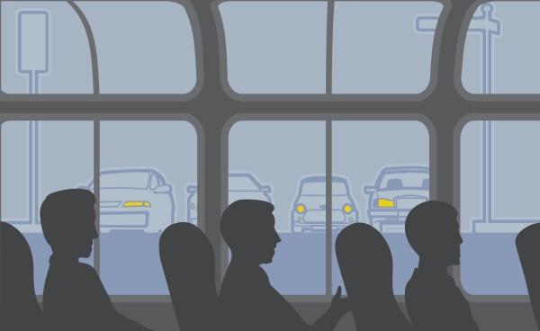 drei personen sitzen in einem bus
