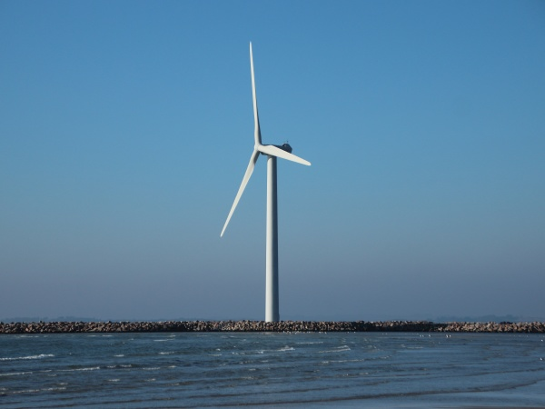 single isolated offshore windmill turbine at