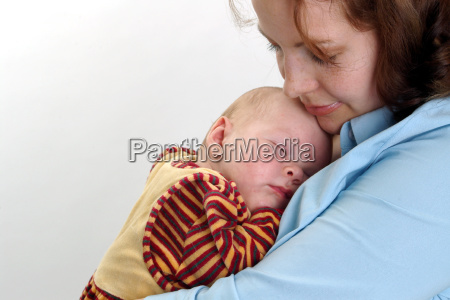 baby sleeping in mothers arms