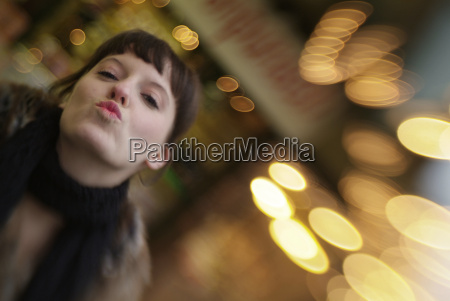 woman sends kiss