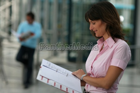 woman studying man in the background