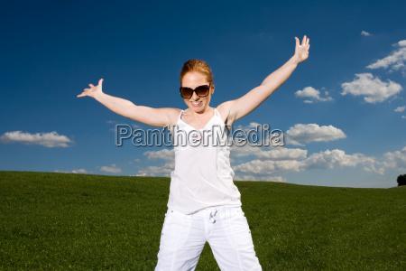 woman pulls arms raised