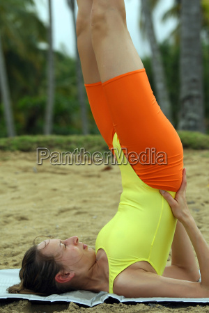 yoga exercise on the beach