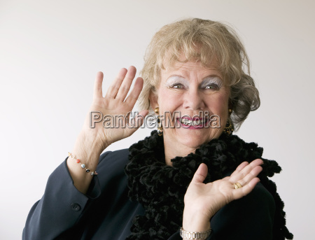 dramatic senior woman witha boa