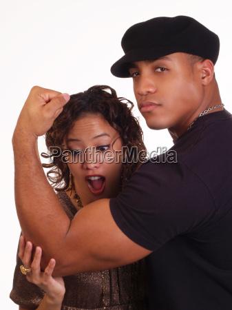 woman looking a black mans biceps