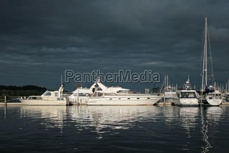 evening harbor thunderstorm thundreous sailing ship