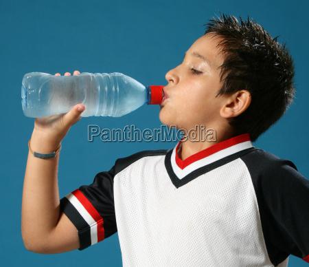 thirsty boy drinking water