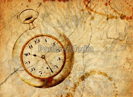 background with pocket watch in grunge