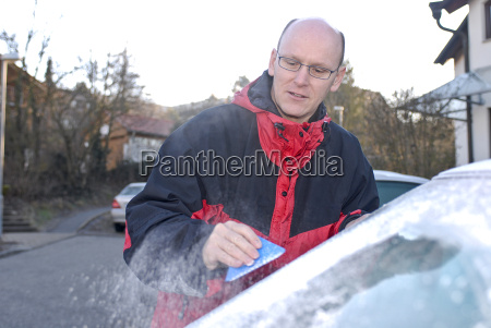ice scratching on the windshield