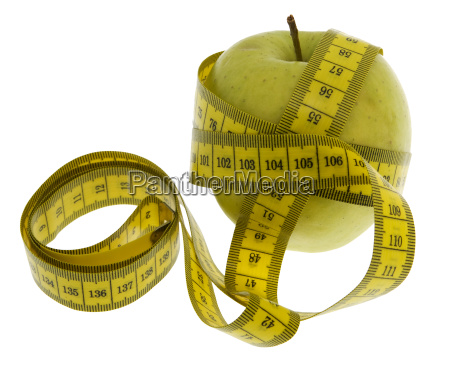 dieting apple with tape measure