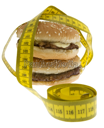 fast food hamburger with measuring tape