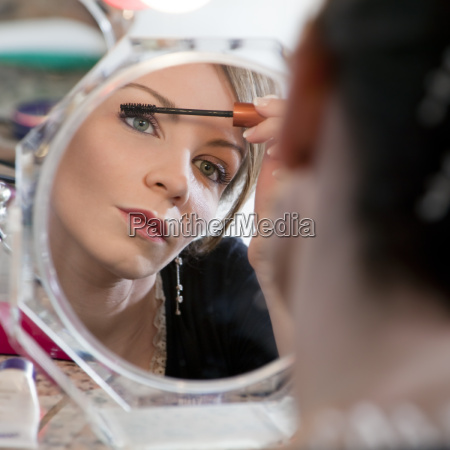 woman looking at mirror