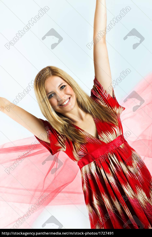 99fd20c2a69 Junge Frau mit rotem Kleid - Lizenzfreies Bild -  1727491 ...