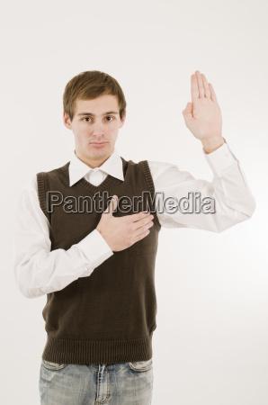 young man take an oath