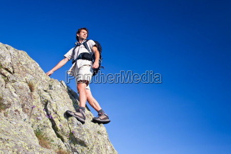 young man standing on a rock