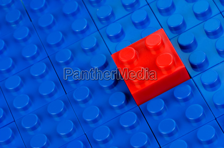 red block inserted in blue
