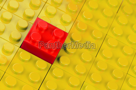 red block inserted into yellow