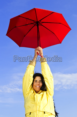 beautiful young woman in raincoat with