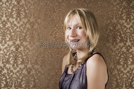 young blonde girl with braces