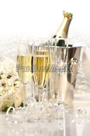 champagne and a bouguet of roses