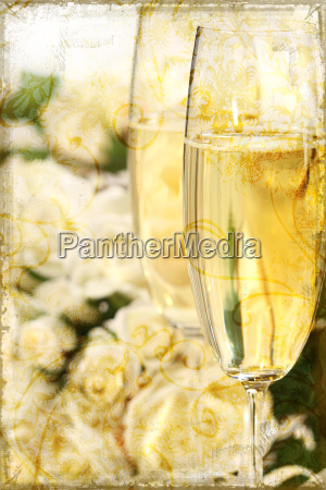 close up of champagne glasses with