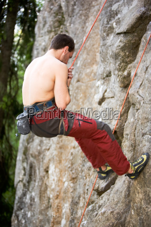 male climber repelling