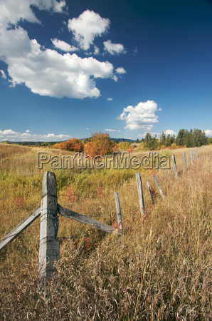 beautiful fall landscape with rustic fence