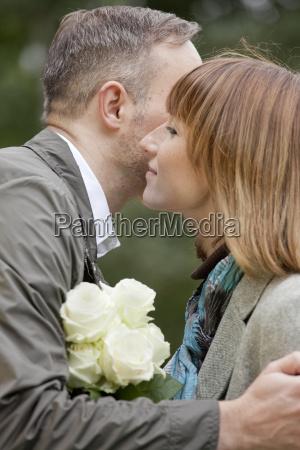 man kissing woman at meeting
