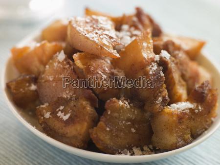 dish of chicharrones mit meersalzflocken
