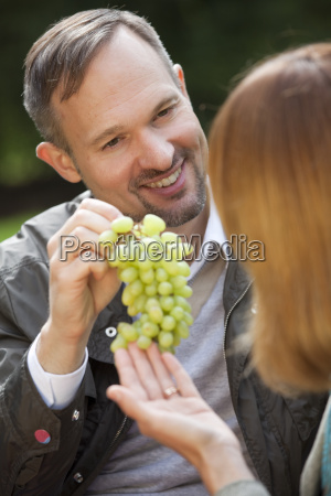 man with grapes