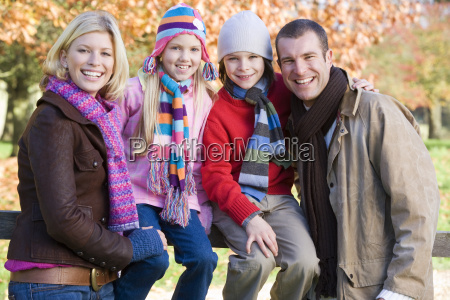 family outdoors in park smiling selective