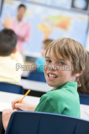 student in class looking at camera