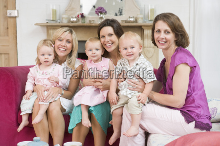 three mothers in living room with
