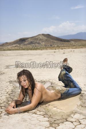 topless muddy woman